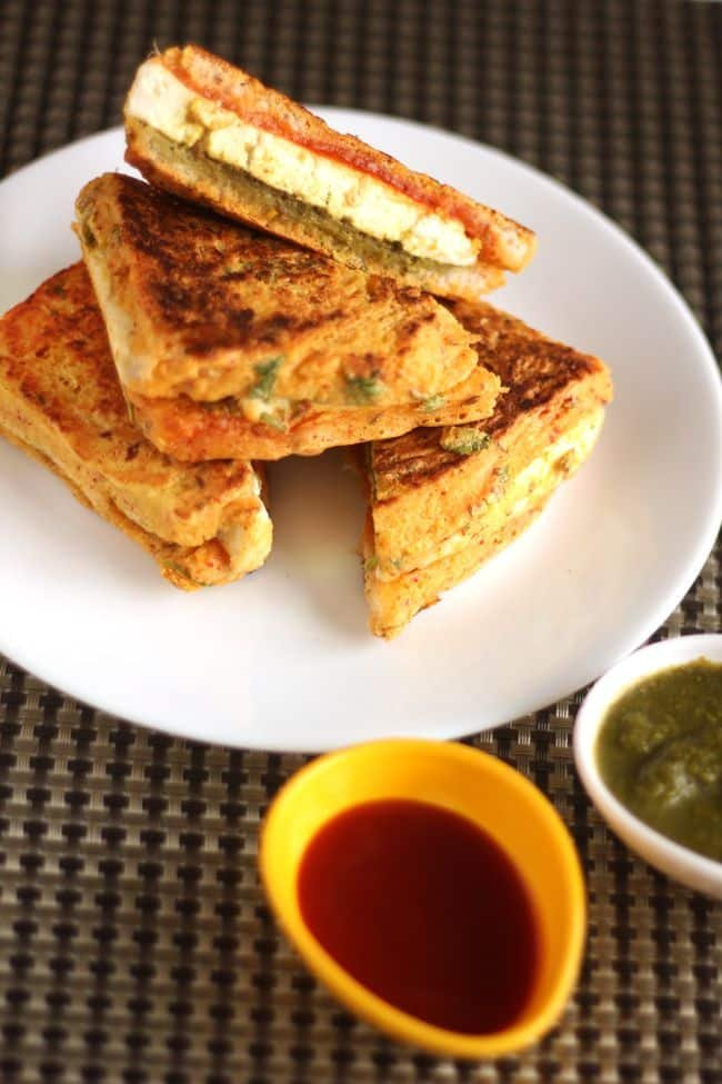 How to make bread paneer pakora recipe paneer recipes mints recipes bread paneer pakoda on a white plate with some tomato ketchup and green chutney on a forumfinder Choice Image