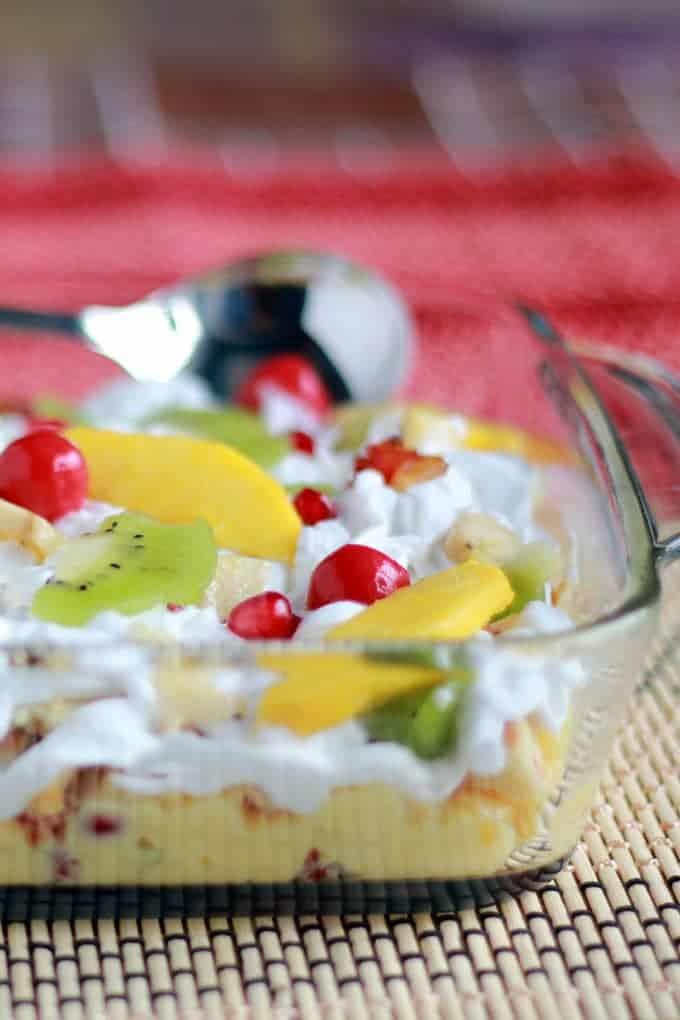 Eggless Fruit Trifle pudding on a square borosil bowl
