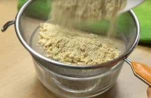 Kaju powder in the sieve