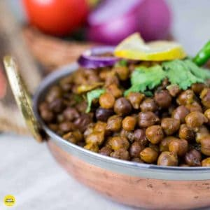 Dry Kala chana recipe pressure cooked with some oil, whole gram spices and onion with some masala and coriander leaves and cooked it till get soft|