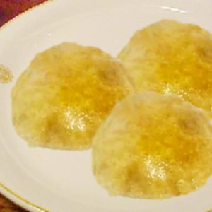 kuttu ki puri on a white plate