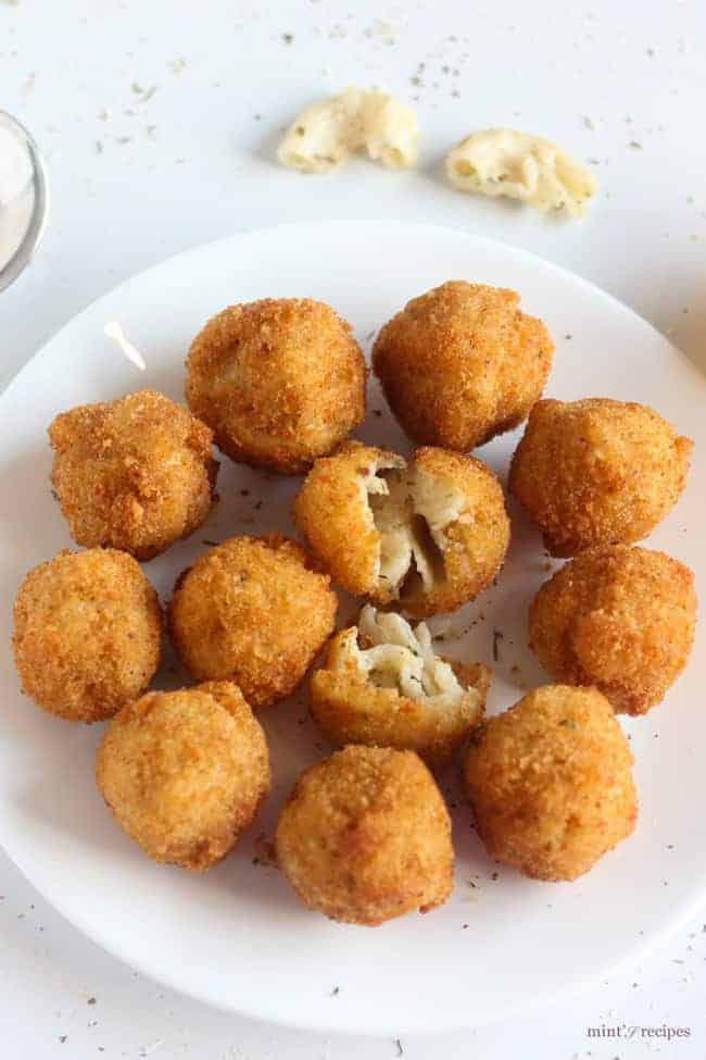 Macaroni cheese balls on a white plate