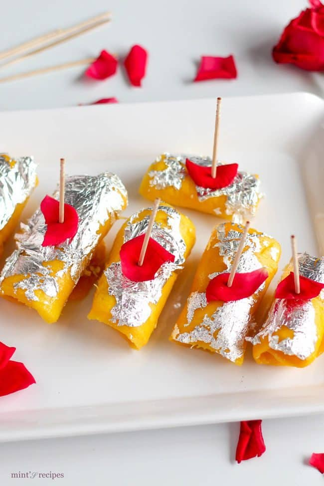 Mango Cheese Rolls beautifully decorated with silver leafs and rose petels