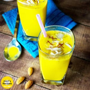 Mango Lassi on a glass with some ice cubes