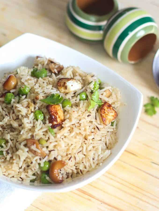 Matar paneer pulao in a white bowl