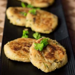 Moong dal ki tikki on a black plate