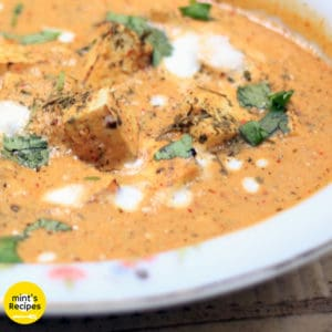Paneer butter masala on a floural printed plate