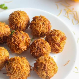 Paneer Vermicelli Balls a quick and easy recipe made with vermicelli on a white plate with some sev sprinklers on the ballsand garnished with some coriander leaves |