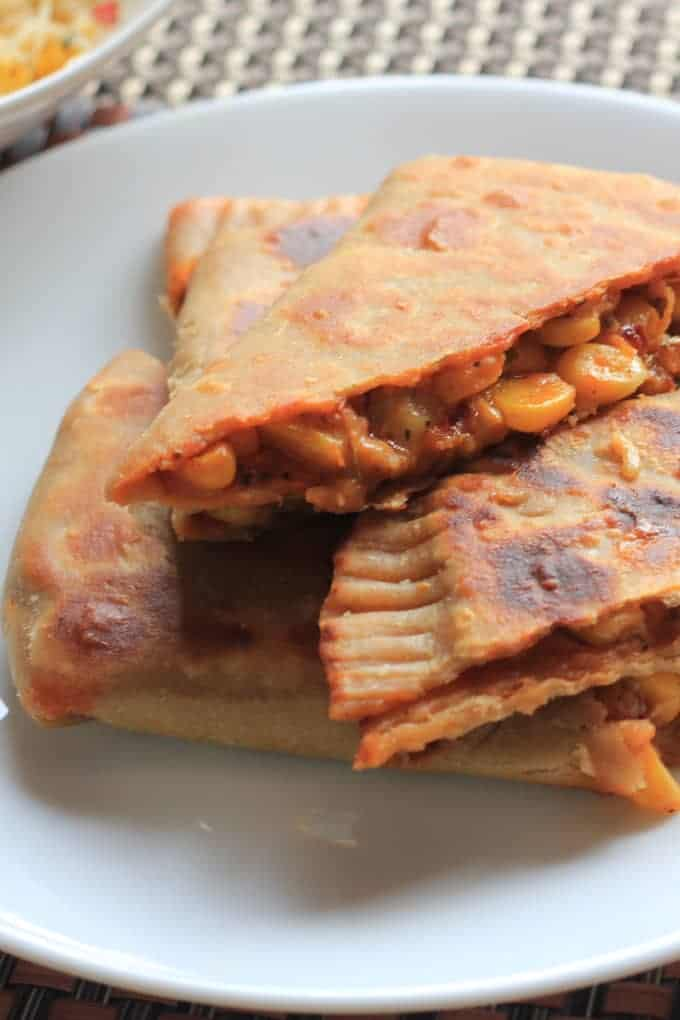 Pizza paratha on a black plate
