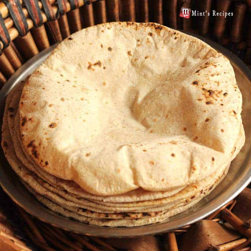 Roti, Chapati, Phulka on a steel plate in the wooden basket