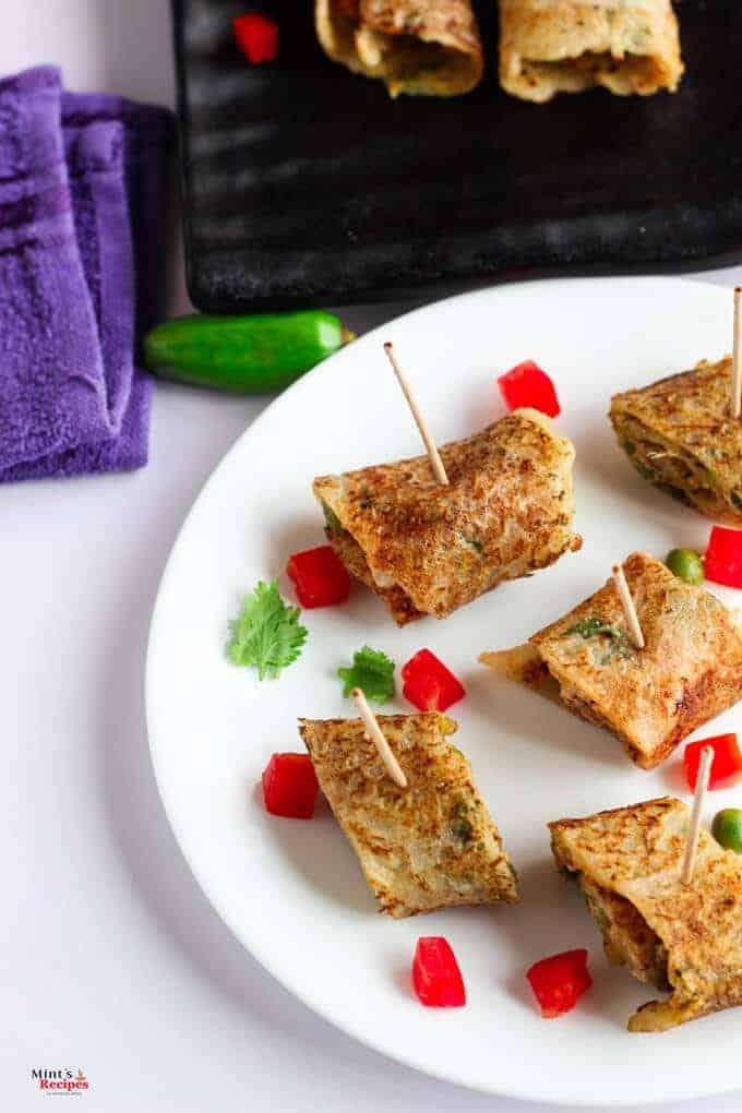 Suji Potato Rolls on a white plate with some chopped veggies   Suji Recipe