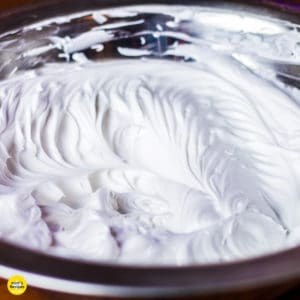 Whipped cream on a glass bowl