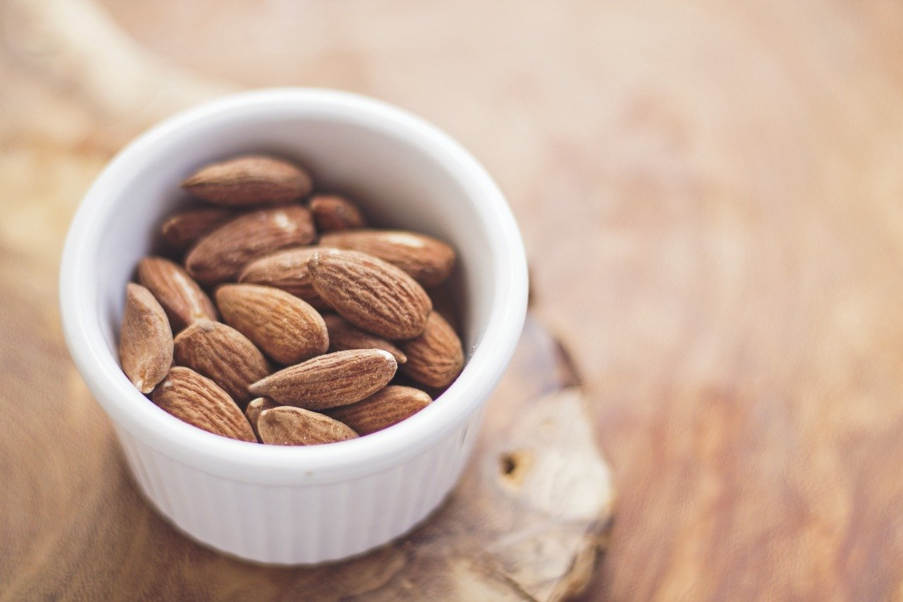 Almonds served in a white bowl