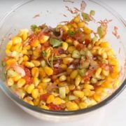 Corn Salad palced on white plate in a bowl