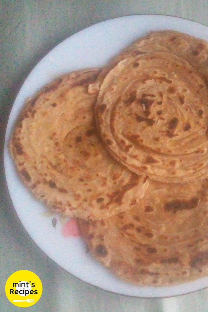 Lacch Paratha on a white flower printed plate