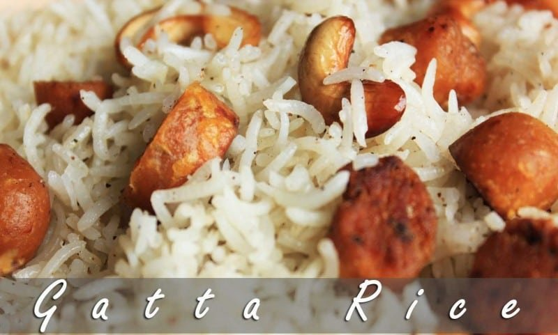 Rajasthani gatte ka pulao on a white plate garnished with fried cashew and gatte  