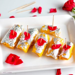 Mango Cheese Rolls Recipe |Sweet Mango Slices filled with paneer stuffing and beautifully decorated with silver leafs and rose petels