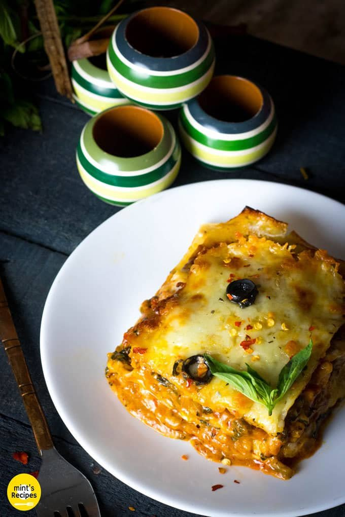 Italian Lasagna with cheese served on a white plate