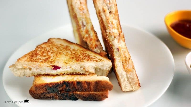 Veg Curd Sandwich on a wooden surface with some green chutney and tomato sauce   www.mintsrecipes.com  