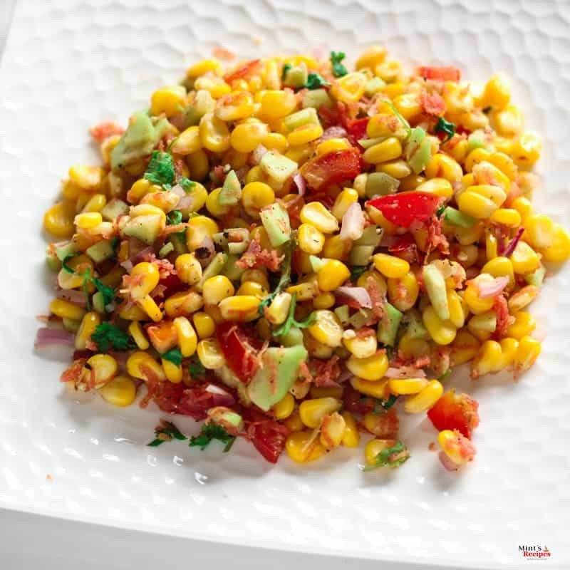 Corn Salad palced on white plate