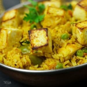 Paneer Butter Masala with peas and coriander leaves