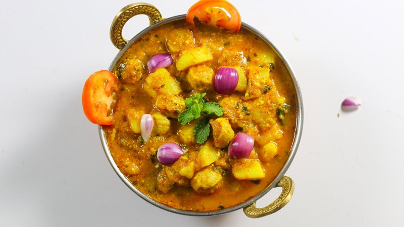 Potato Soyabean Ki Sabzi with Onion and Tomato toppings