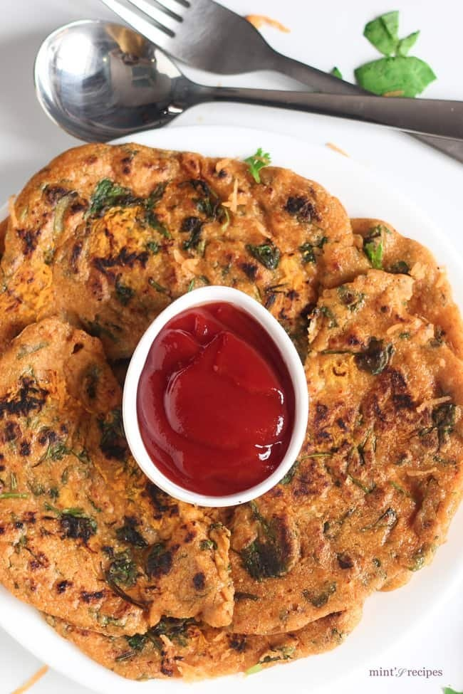 Oats Pancake on a white plate with tomato ketchup