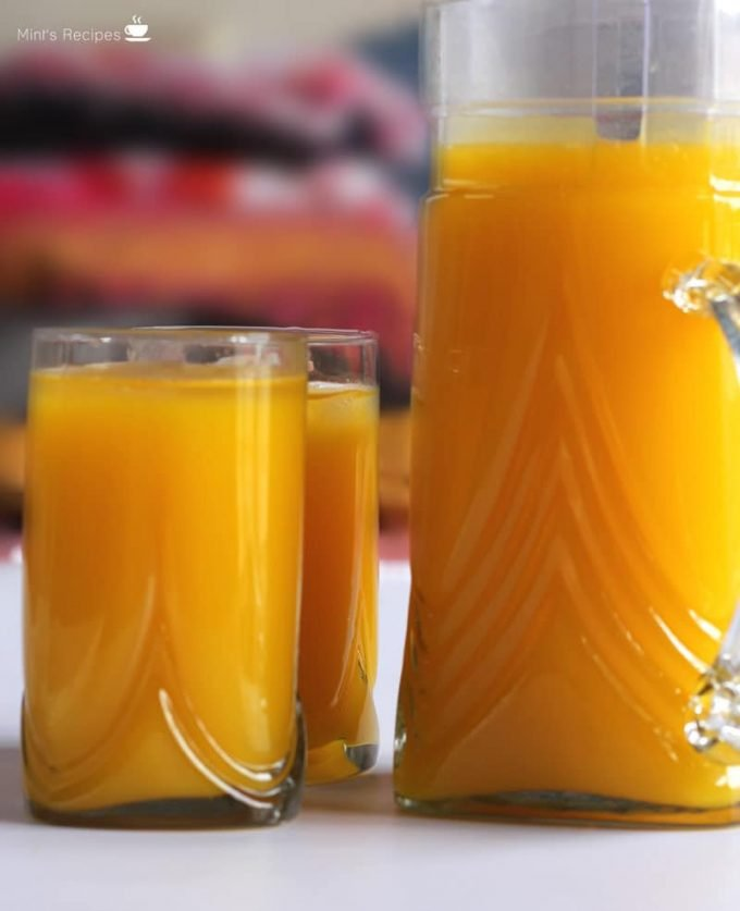 Mango Frooti sweet, thick and smooth mango juice filled in the jug ands glasses with a blur background |